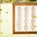 In lieu of placecards, table rosters were framed and hung at eye level for guests to find their seats.