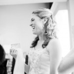 Kristen shares a laugh with her bridesmaids and parents before the ceremony