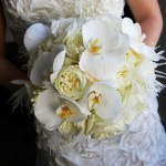 Luscious orchids, garden roses and feathers in Melissa's bouquet.