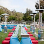 Warm red blankets line picnic benches to keep guests warm