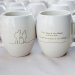 Coffee mugs, designed by a friend of the brides, were used on the dessert display and doubled as favors
