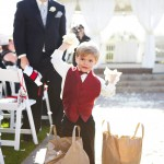 "A ring bearer ""helps"" us decorate just before the ceremony"