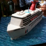 """Carnival Pride"" - the ship the bride and groom met on replicated in sugar and fondant.  Mikey was floored when we brought this out for dessert!"