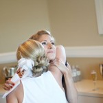 A bridesmaid gives an emotional embrace