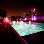 Internally lit orbs were floated in the pool and an existing garden structure was wrapped in market lights for a magical effect